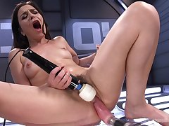 Juliette March uses a fuck machine and vibrator on her hungry pussy