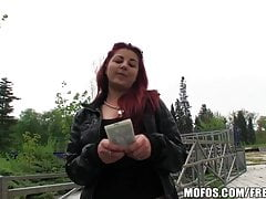 Sexy redhead amateur is fucked in a park for some cash