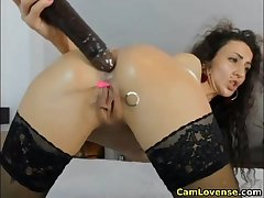 Horny brunette girl fucking her pussy beside lovense vibrator
