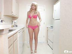 Cute blonde in heels uses a dildo