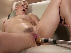 Short haired kirmess Helena Locke rides a making out machine