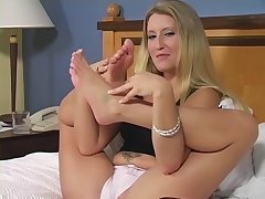 Flexible blonde goddess massaging and ribbons her wonderful toes in bed