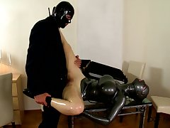 Latex Lucy gets fucked by her male slave and she licks his balls